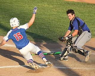 William D. Lewis The Vindicator Western Reserve's Garrett Milhalick(15) is out at the plate as Jax Milton Catcher Noah LAaster(5) makes the tag)  in 11 inning game with Jackson Milton at Cene 5-19-17