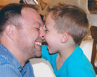 Chris Prater of New Middletown, with his 5 year-old son, Camden.
