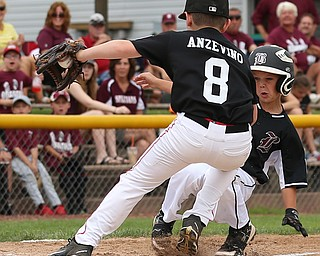 MICHAEL G TAYLOR | THE VINDICATOR-7-15-17  BASEBALL 8-10 yrs. Ohio D2 Championship- Boardman Spartans vs Canfield Cardinals at Field of Dreams in Boardman, OH. 1st, Canfield #8 Noah Anzevino tags out  Boardman's #18 Kaden Mayhew who was trying to score on a wild pich.