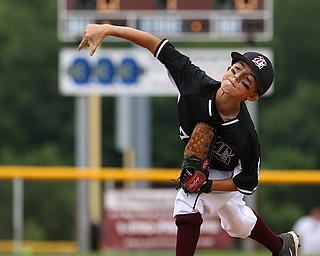 MICHAEL G TAYLOR | THE VINDICATOR-7-15-17  BASEBALL 8-10 yrs. Ohio D2 Championship- Boardman Spartans vs Canfield Cardinals at Field of Dreams in Boardman, OH. 1st, Boardman's #7 Anthony Triveri fires a pitch homeward.