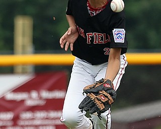 MICHAEL G TAYLOR | THE VINDICATOR-7-15-17  BASEBALL 8-10 yrs. Ohio D2 Championship- Boardman Spartans vs Canfield Cardinals at Field of Dreams in Boardman, OH. 2nd,  Canfield's #27 Zain Jadallah fielding the ball. Ball took a bad bounce.