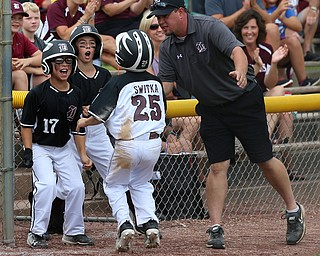 MICHAEL G TAYLOR | THE VINDICATOR-7-15-17  BASEBALL 8-10 yrs. Ohio D2 Championship- Boardman Spartans vs Canfield Cardinals at Field of Dreams in Boardman, OH. 2nd, Boardman's #25 Max Switka celebrates scoring with his teammates
