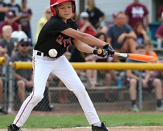 MICHAEL G TAYLOR | THE VINDICATOR-7-15-17  BASEBALL 8-10 yrs. Ohio D2 Championship- Boardman Spartans vs Canfield Cardinals at Field of Dreams in Boardman, OH. 2nd, Canfield #5 Ray Mccune swings and misses.