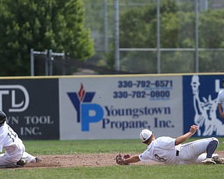 Brooklyn Bonnie Paws right fielder Tony Holden (10) slides past Baird Brothers short stop Austin Vogt (8) in the fourth inning as the Baird Brothers take on the Brooklyn Bonnie Paws in the 14u NABF World Series Championship, Sunday, July 16, 2017, at Cene Park in Struthers. Brooklyn won 2-0...(Nikos Frazier   The Vindicator)..