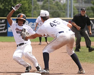 Brooklyn Bonnie Paws center fielder Joseph Narvaez (33) slides out into Baird Brothers third baseman Bren Kilpatrick (45) in the fourth inning as the Baird Brothers take on the Brooklyn Bonnie Paws in the 14u NABF World Series Championship, Sunday, July 16, 2017, at Cene Park in Struthers. Brooklyn won 2-0...(Nikos Frazier   The Vindicator)..