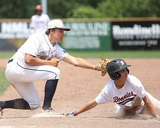 Baird Brothers first baseman Jake Gehring (9) tags out Brooklyn Bonnie Paws pitcher Thomas Pallazoito (1) in the sixth inning as the Baird Brothers take on the Brooklyn Bonnie Paws in the 14u NABF World Series Championship, Sunday, July 16, 2017, at Cene Park in Struthers. Brooklyn won 2-0...(Nikos Frazier   The Vindicator)..
