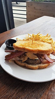 The Lumberjack Burger - two fried local eggs, four strips of Ohio bacon, maple syrup, sourdough