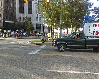 "Guy trolls counter rally with this truck; man shouts ""it's the devil's truck."" Another driver flips him off."