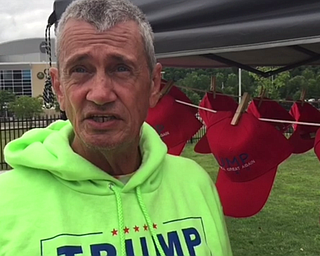 David Dickson, of Florida, selling Trump merchandise outside of Covelli Centre.