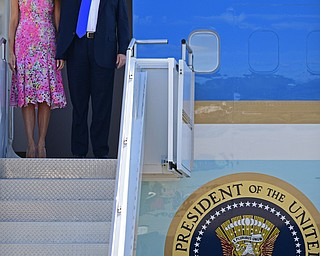 President Donald Trump salutes as he exits Air Force One with first lady Melania Trump at the Youngstown-Warren Regional Airport, Tuesday, Tuesday, July 25, 2017, in Vienna, Ohio. Trump will be speaking at a rally Tuesday at the Covelli Centre in Youngstown, Ohio. (David Dermer/The Vindicator via AP)