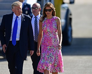 President Donald Trump walks with first lady Melania Trump at the Youngstown-Warren Regional Airport, Tuesday, Tuesday, July 25, 2017, in Vienna, Ohio. Trump will be speaking at a rally Tuesday at the Covelli Centre in Youngstown, Ohio. (David Dermer/The Vindicator via AP)
