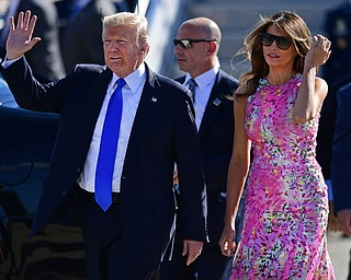 President Donald Trump waves as he walks with first lady Melania Trump at the Youngstown-Warren Regional Airport, Tuesday, Tuesday, July 25, 2017, in Vienna, Ohio. Trump will be speaking at a rally Tuesday at the Covelli Centre in Youngstown, Ohio. (David Dermer/The Vindicator via AP)