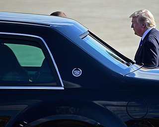 President Donald Trump enters a car at the Youngstown-Warren Regional Airport, Tuesday, Tuesday, July 25, 2017, in Vienna, Ohio. Trump will be speaking at a rally Tuesday at the Covelli Centre in Youngstown, Ohio. (David Dermer/The Vindicator via AP)
