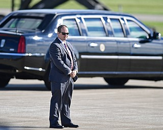 A secret service agent stands on the runway as President Donald Trump motorcade drives away at the Youngstown-Warren Regional Airport, Tuesday, Tuesday, July 25, 2017, in Vienna, Ohio. Trump will be speaking at a rally Tuesday at the Covelli Centre in Youngstown, Ohio. (David Dermer/The Vindicator via AP)