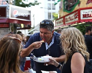 Adam Burke of Sandy Springs, Ga. enjoys a strombolli from LaRocca during the Greater Youngstown Italian Festival, Saturday, August 5, 2017 in Downtown Youngstown...(Nikos Frazier | The Vindicator)