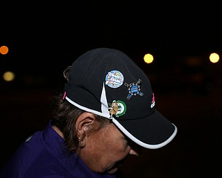 Gina Harper, aunt of Brooke Bobbey, shows off her pins from the game the Softball Little League World Series Champions return home, Sunday, August 6, 2017 in Poland...(Nikos Frazier | The Vindicator)