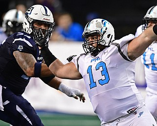 Philadelphia Soul defensive linemen Zach Zidian rushes the passer while being locked by Baltimore Brigade offensive linemen Kody Afusia on July 29, 2017 at Royal Farms Arena in Baltimore, Maryland. DAVID DERMER | THE VINDICATOR