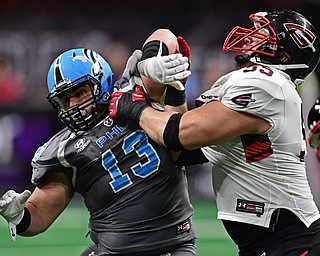 Philadelphia Soul defensive linemen Zach Zidian rushes the passer while being blocked by Cleveland Gladiators offensive linemen Adam Bice during their game on June 10, 2017 at the Wells Fargo Center in Philadelphia, Pennsylvania. DAVID DERMER | THE VINDICATOR