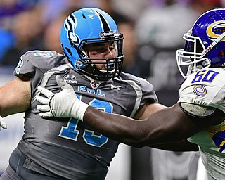 Philadelphia Soul defensive linemen Zach Zidian rushes the passer while being blocked by Tampa Bay Storm offensive linemen Jeremiah Warren during their game on June 17, 2017 at the Wells Fargo Center in Philadelphia, Pennsylvania. DAVID DERMER | THE VINDICATOR