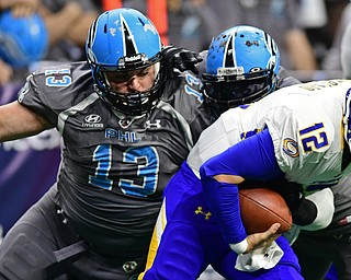 Philadelphia Soul defensive linemen Zach Zidian and linebacker Beau Bell sack Tampa Bay Storm quarterback Randy Hippeard during their game on June 17, 2017 at the Wells Fargo Center in Philadelphia, Pennsylvania. DAVID DERMER | THE VINDICATOR