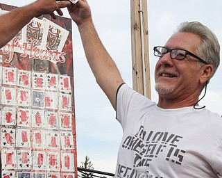 William D Lewis The Vindicator  Crickets Queen of Hearts winner John Riley of Youngstown holds winning card after winning 8-14-17.