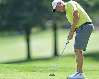 POLAND, OHIO - AUGUST 20, 2017: Scott Jones putts on the 1st hole during the final round of the Vindy Greatest Golf Tournament, Sunday afternoon at the Lake Club. DAVID DERMER | THE VINDICATOR