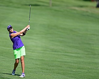 POLAND, OHIO - AUGUST 20, 2017: Toni Notaro follows through on her approach shot on the 8th hole during the final round of the Vindy Greatest Golf Tournament, Sunday afternoon at the Lake Club. DAVID DERMER | THE VINDICATOR