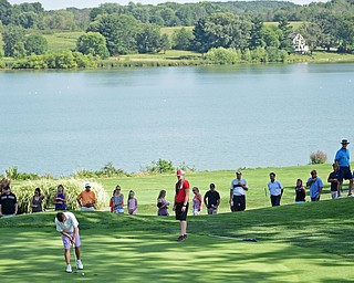POLAND, OHIO - AUGUST 20, 2017: Members of the gallery watch as Todd Karzmer putts on the 8th hole during the final round of the Vindy Greatest Golf Tournament, Sunday afternoon at the Lake Club. DAVID DERMER | THE VINDICATOR