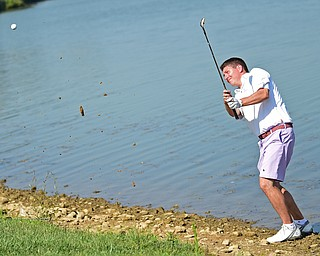 POLAND, OHIO - AUGUST 20, 2017: Jonah Karzmer chips out of the rocks on the 9th hole during the final round of the Vindy Greatest Golf Tournament, Sunday afternoon at the Lake Club. DAVID DERMER | THE VINDICATOR