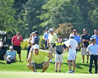 POLAND, OHIO - AUGUST 20, 2017: Scott Jones reads the green on the 9th hole during the final round of the Vindy Greatest Golf Tournament, Sunday afternoon at the Lake Club. DAVID DERMER | THE VINDICATOR
