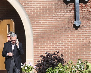YSU President Jim Tressel talks on his phone during former state Sen. Harry Meshel's funeral, Sept. 9, 2017, at St. Nicholas Greek Orthodox Church in Youngstown...(Nikos Frazier | The Vindicator)