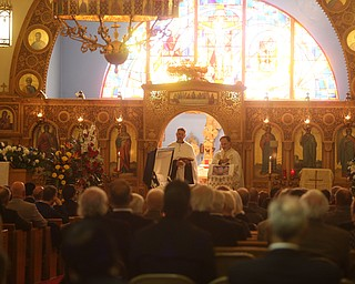 Fr. Joseph DiStefano and Fr. Steve Denas preside over former state Sen. Harry Meshel's funeral, Sept. 9, 2017, at St. Nicholas Greek Orthodox Church in Youngstown...(Nikos Frazier | The Vindicator)