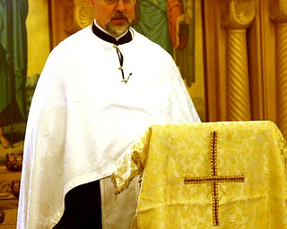 Fr. Joseph DiStefano presides over former state Sen. Harry Meshel's funeral, Sept. 9, 2017, at St. Nicholas Greek Orthodox Church in Youngstown...(Nikos Frazier | The Vindicator)