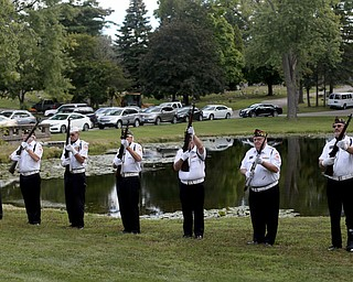 Honor guard members fire a 21 gun salute during former state Sen. Harry Meshel's funeral, Sept. 9, 2017, at Belmont Park Cemetery in Youngstown...(Nikos Frazier | The Vindicator)