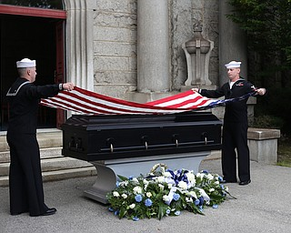 HM2 Todd Bollinger and GM3 Joshua Kramer of NOSC Youngstown fold the flag during former state Sen. Harry Meshel's funeral, Sept. 9, 2017, at Belmont Park Cemetery in Youngstown...(Nikos Frazier | The Vindicator)