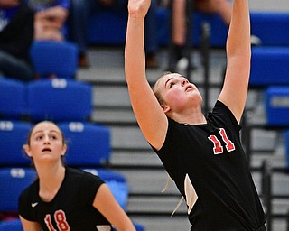 HUBBARD, OHIO - SEPTEMBER 12, 2017: Canfield's Alyssa Householder, right, sets the ball up for Grace Mangapora during their match, Tuesday night at Hubbard High School. DAVID DERMER | THE VINDICATOR