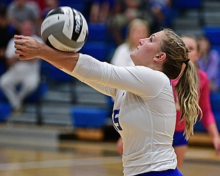 HUBBARD, OHIO - SEPTEMBER 12, 2017: Hubbard's Kristin Fahndrich hits the ball during their match, Tuesday night at Hubbard High School. DAVID DERMER | THE VINDICATOR