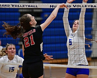 HUBBARD, OHIO - SEPTEMBER 12, 2017: Hubbard's Silvia Genoni, right, goes for the block of the shot from Canfield's Alexis Metille during their match, Tuesday night at Hubbard High School. DAVID DERMER | THE VINDICATOR