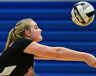 HUBBARD, OHIO - SEPTEMBER 12, 2017: Canfield's Alyssa Householder hits the ball during their match, Tuesday night at Hubbard High School. DAVID DERMER | THE VINDICATOR