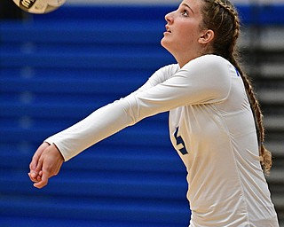 HUBBARD, OHIO - SEPTEMBER 12, 2017: Hubbard's Silvia Genoni bumps the ball during their match, Tuesday night at Hubbard High School. DAVID DERMER | THE VINDICATOR