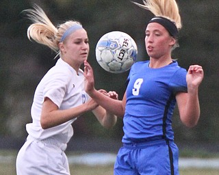 William D. Lewis the Vindicator  Lakeview's Reagan Roenberger(9) and Polands Carolyn Boccieri(17) during 9-13-17 action in Poland/