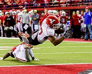 Youngstown State tailback Tevin McMaster (37) dives into the end zone for a touchdown against University of South Dakota during the first half at the DakotaDome on Saturday, Oct. 7, 2017 in Vermillion, S.D.