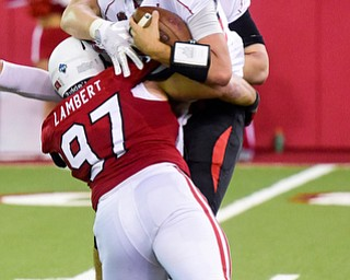 Youngstown State quarterback Nathan Mays (7) gets sacked by University of South Dakota defensive tackle Taylor Lambert (97) on the last play of the game during the second half at the DakotaDome on Saturday, Oct. 7, 2017 in Vermillion, S.D.