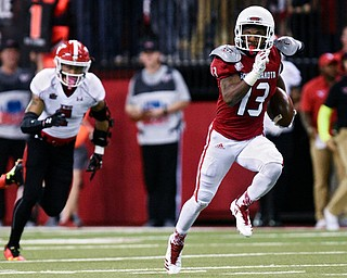 University of South Dakota wide receiver Shamar Jackson(13) runs down the field for a touchdown during the second half at the DakotaDome on Saturday, Oct. 7, 2017 in Vermillion, S.D.