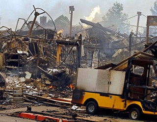 The Hilton hotel is destroyed Monday, Oct. 9, 2017, in Santa Rosa, Calif. Wildfires whipped by powerful winds swept through Northern California early Monday, sending residents on a headlong flight to safety through smoke and flames as homes burned. (AP Photo/Ben Margot)