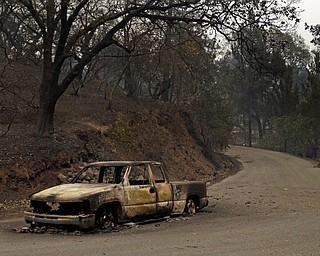 Remains of a car seen on Crystal Drive Monday, Oct. 9, 2017, in Santa Rosa, Calif. Wildfires whipped by powerful winds swept through Northern California early Monday, sending residents on a headlong flight to safety through smoke and flames as homes burned. (AP Photo/Ben Margot)