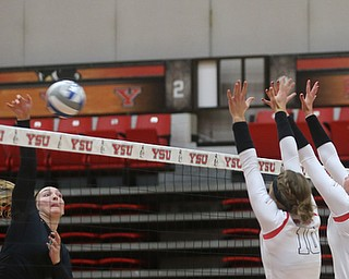 Wright State University outside hitter Katie Klusman (12) goes up for the spike against Youngstown State University Outside Hitter Erin Kalahar (10) and Youngstown State University Outside Hitter Sam Brown (20) during the first set as Wright State University takes on Youngstown State University, Wednesday, Oct. 11, 2017, at the Beeghly Center at Youngstown State University in Youngstown. The Raiders won the set 3-1, loosing set 1 30-32 and winning set 2 25-16, set 3 25-17 and set 4 25-22...(Nikos Frazier | The Vindicator)..