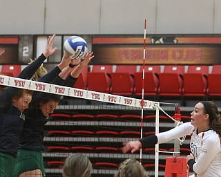 Youngstown State University Outside Hitter Sam Brown (20) spikes the ball during the first set as Wright State University takes on Youngstown State University, Wednesday, Oct. 11, 2017, at the Beeghly Center at Youngstown State University in Youngstown. The Raiders won the set 3-1, loosing set 1 30-32 and winning set 2 25-16, set 3 25-17 and set 4 25-22...(Nikos Frazier | The Vindicator)..