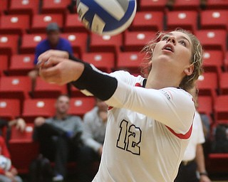 Youngstown State University Outside Hitter Margaux Thompson (12) hits the ball during the third set as Wright State University takes on Youngstown State University, Wednesday, Oct. 11, 2017, at the Beeghly Center at Youngstown State University in Youngstown. The Raiders won the set 3-1, loosing set 1 30-32 and winning set 2 25-16, set 3 25-17 and set 4 25-22...(Nikos Frazier | The Vindicator)..