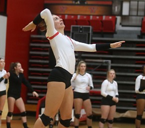 Youngstown State Unversity Setter Libbie Darling (9) serves during the fourth set as Wright State University takes on Youngstown State University, Wednesday, Oct. 11, 2017, at the Beeghly Center at Youngstown State University in Youngstown. The Raiders won the set 3-1, loosing set 1 30-32 and winning set 2 25-16, set 3 25-17 and set 4 25-22...(Nikos Frazier | The Vindicator)..